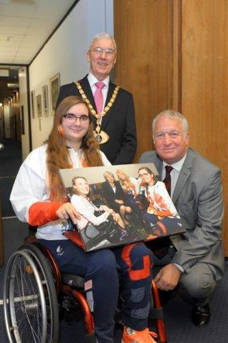 MP Mike Penning presenting Jess with signed photograph