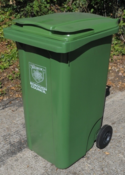 A green wheeled bin showing the Dacorum Borough Council logo