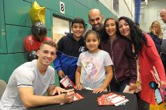 Max Whitlock signs autographs for visitors