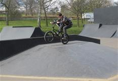 A boy on his BMX bike doing a bunny hop at Gadebridge Park skate park
